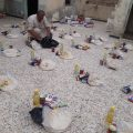 توزيع مساعدات غذائية في الرقة