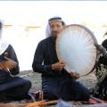 سوسن، مغنية وعازفة على الدف في فرقة إحياء التراث في الرقة